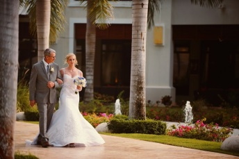 Picture of father walking bride down the aisle at Dreams Palm Beach destination wedding