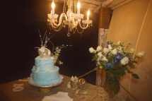 Picture of wedding cake and chandelier at Kukua Beach Club Punta Cana