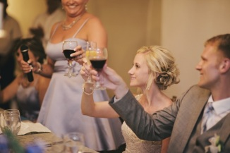 Picture of the bride and groom toasting at wedding reception